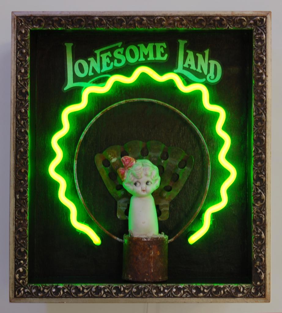 """""""Lonesome Land,"""" neon, vintage doll, flag holder, sheet music, navigation map, vintage frame, by Eve Hoyt"""
